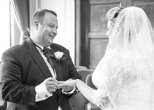 Bride and Groom exchanging wedding bands at Barnsley Town Hall wedding bespoke wedding photography