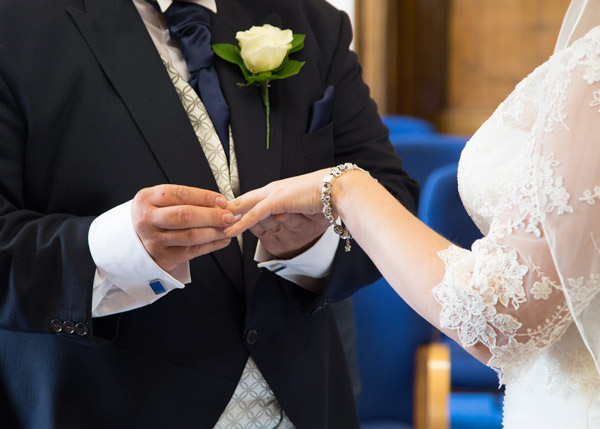 Bride and Groom exchanging rings during a Barnsley Town Hall wedding