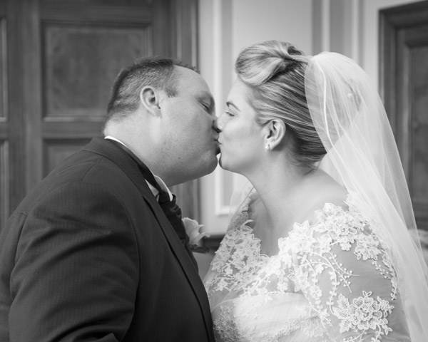 Bride and groom kissing at the Barnsley Town hall after their wedding ceremony