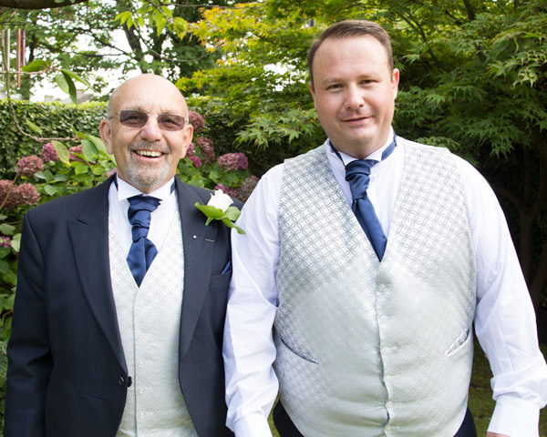 Groom with his Dad in matching cravats at Quintessential catering on Huddersfield road gardens bespoke wedding photography