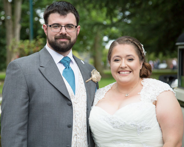 Couple smiling at the camera during Chester Zoo Wedding