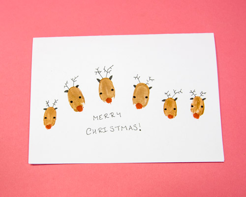 Reindeer finger print Christmas card with Christmas greeting
