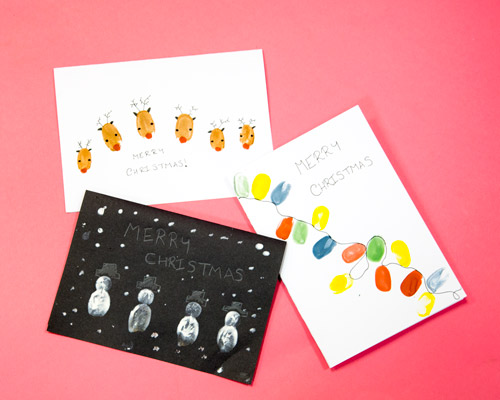 Reindeer snowman and lights finger print Christmas card with Christmas greeting