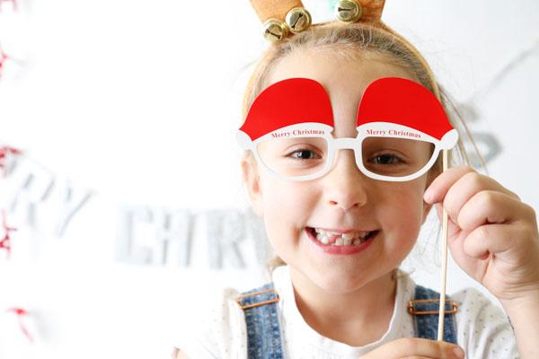 Girl in a festive photobooth at DMC Etsy made local Barnsley