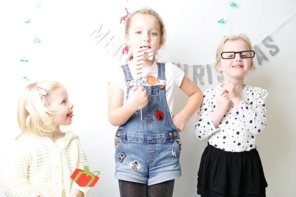 Three girls playing in a photobooth at DMC Barnsley