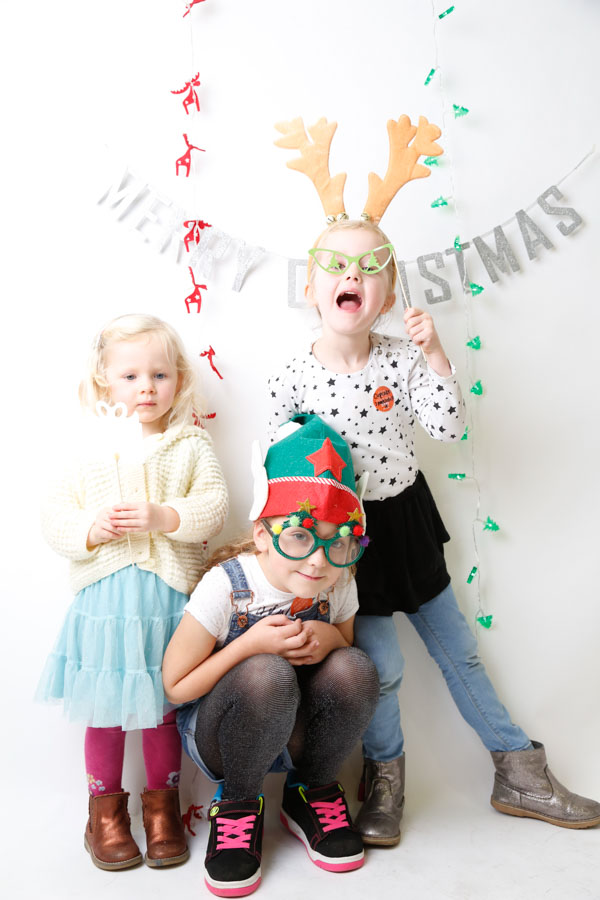 Three girls playing in a photobooth at Etsy Made Local Barnsley 2017