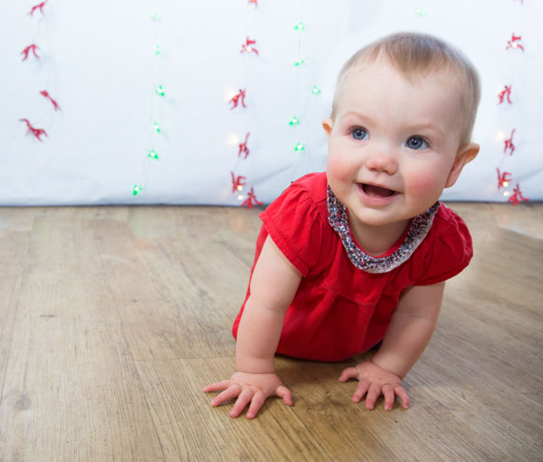 Baby crawling to the camera during a christmas shoot