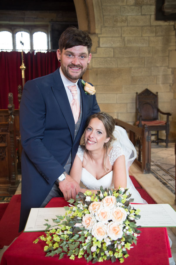 Bride and Groom signing the register in Shafton parish church