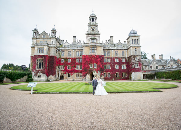 Bride and groom standing in front of Thoresby Hall Hotel