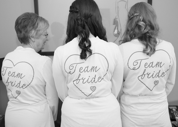 Bridal party in matching team bride dressing gowns with love hearts