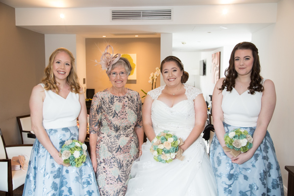 Bridal party with bride in the hotel room at Doubletree by Hilton Hotel Chester