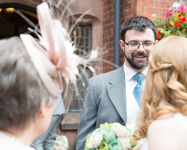 Groom greeting the bridal party at Chester Zoo Wedding