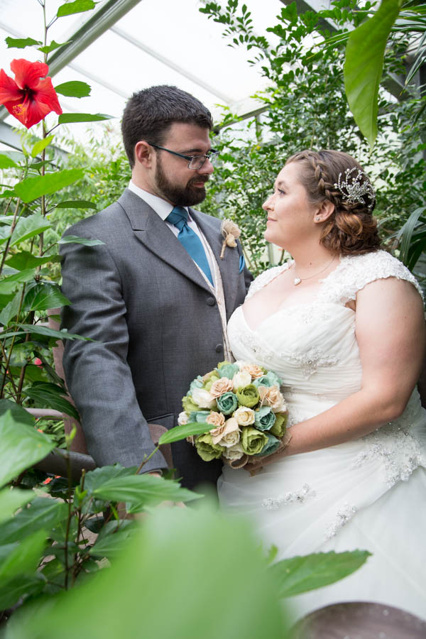 Bride and groom in the butterfly house at Chester Zoo wedding