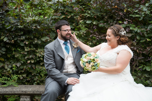 Bride and groom laughing on their wedding day at Chester Zoo