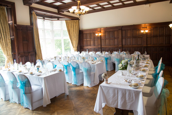 The wedding breakfast room at Oakfield House Chester Zoo decorated with light blue chair sashes