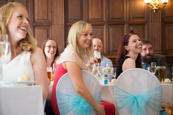 Guests laughing in the wedding breakfast room at Oakfield House CHester Zoo