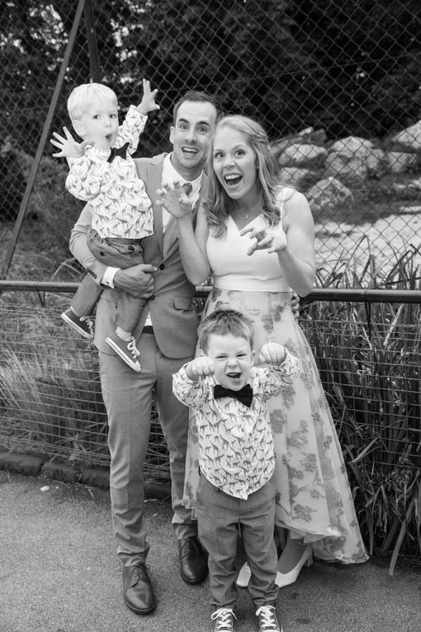 Bridesmaid with her husband and pageboys being Lions at Chester Zoo