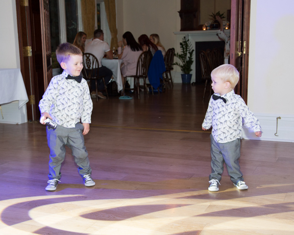 Young boys in giraffe shirts dancing at Chester Zoo wedding