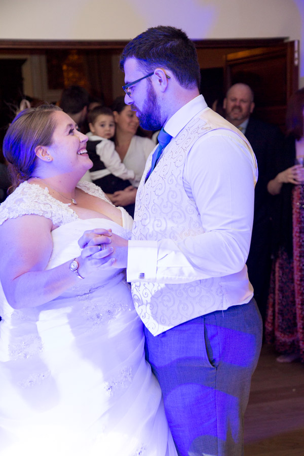 Bride and Groom smiling at each other during their first dance at Chester Zoo wedding