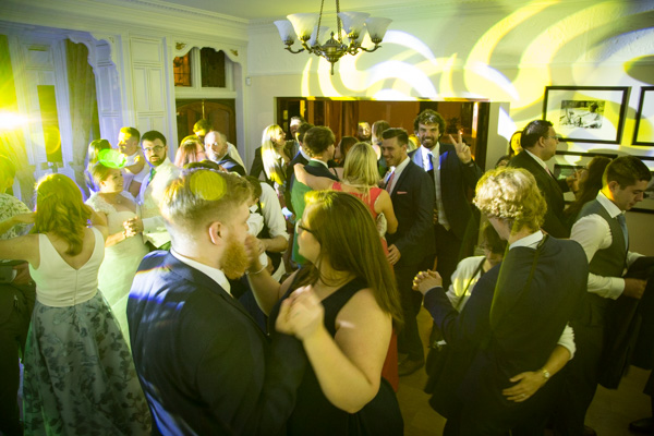 Guests dancing at Chester Zoo wedding first dance song ideas