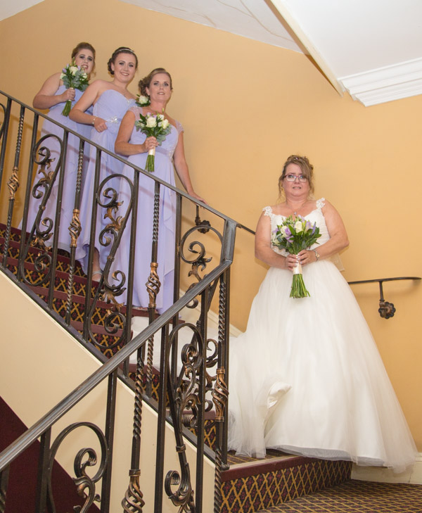 The Bride and Bridesmaids waiting on the stairs of the Holiday Inn Barnsley