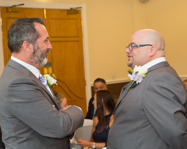 Groom and best man talking before the ceremony
