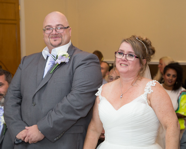 Bride and groom at the front of the ceremony room