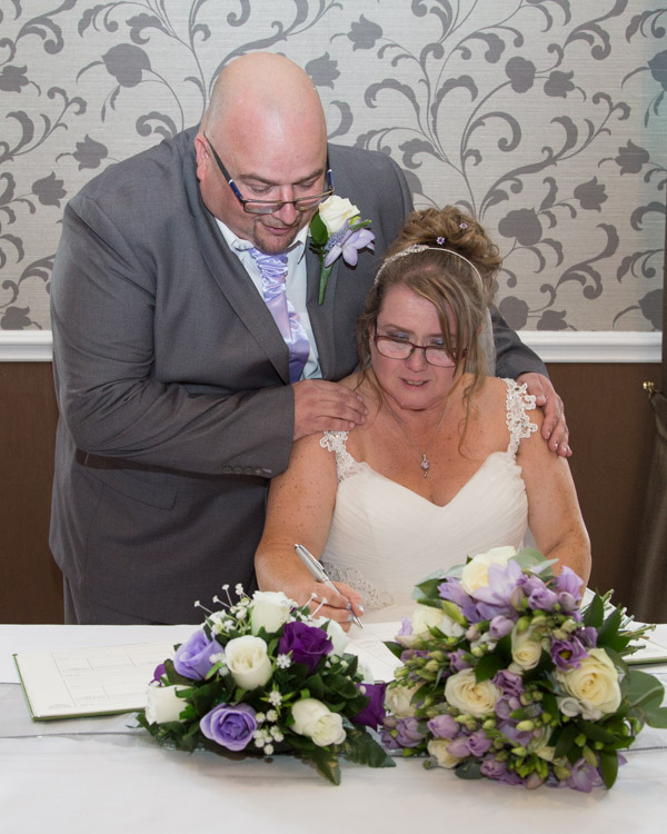 Bride and Groom signing the register at Holiday Inn Barnsley