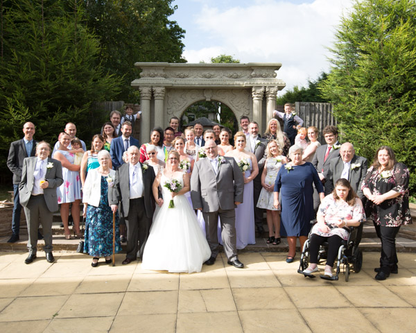 Wedding party shot outside the Secret Garden Holiday Inn Barnsley