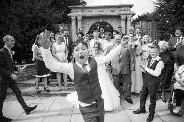 Page boy photobombing a confetti shot at Holiday Inn Barnsley