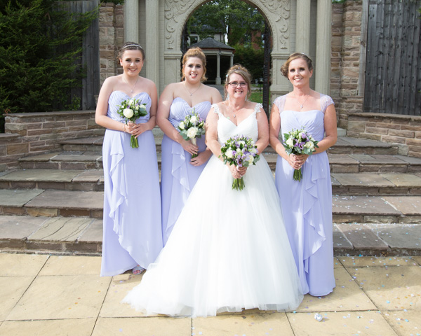 Bride and Bridesmaids in front of the Secret garden Holiday Inn Barnsley
