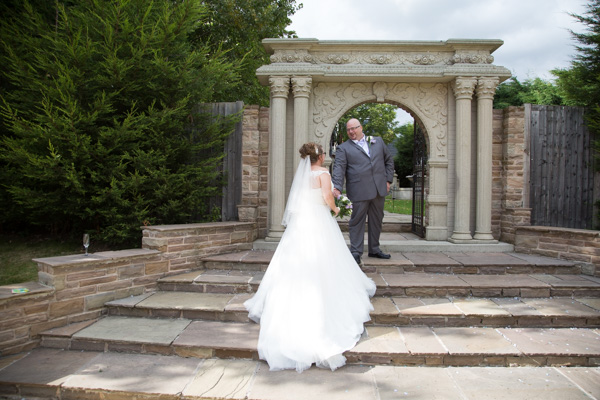 Bride and Groom walking up the steps to the Secret Garden at Holiday Inn Barnsley