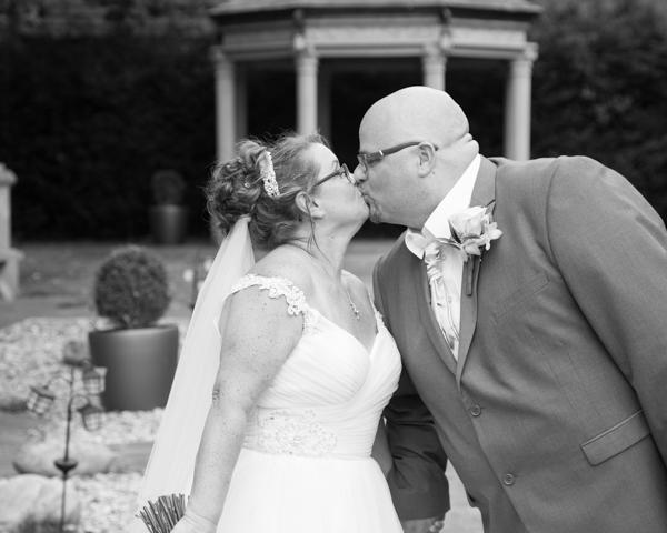 Bride and Groom kiss in the Secret Garden Holiday Inn Barnsley