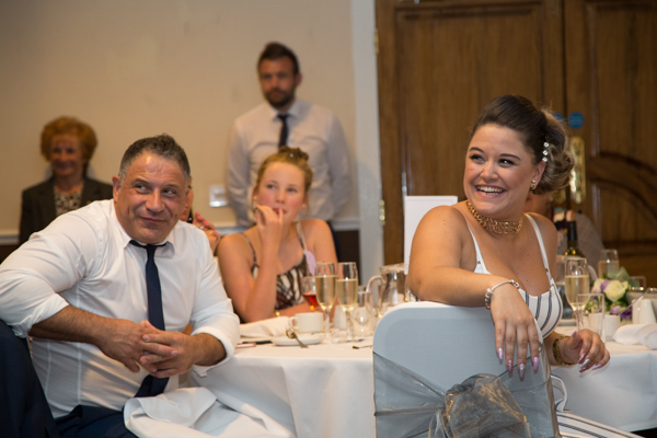 Guests laughing during speeches at Holiday Inn Barnsley wedding