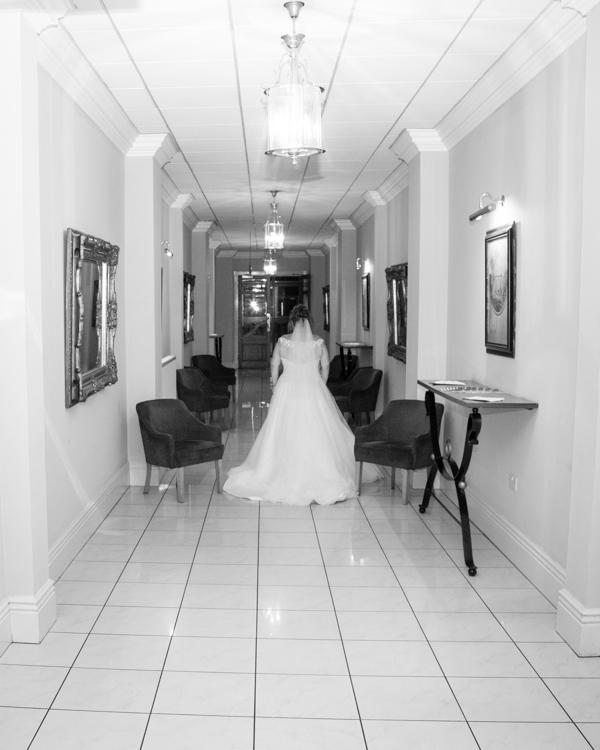 Bride walking down the corridor in the Holiday Inn Barnsley