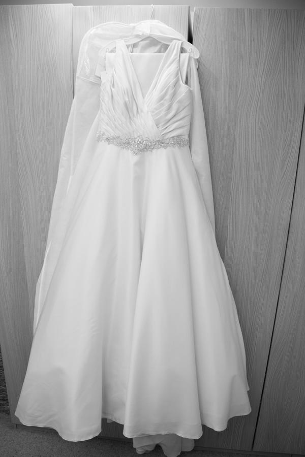 WEdding dress hanginig on wardrobe door before it's worn
