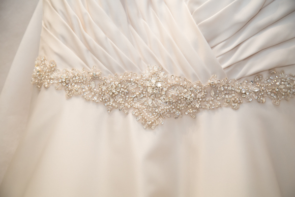 Close up detail of wedding dress belt and pleats