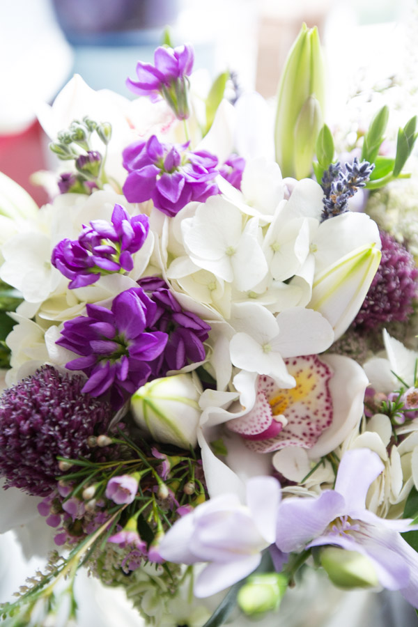 Close up of bridal bouquet with purple and green flowers