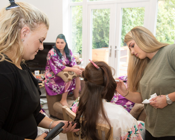 Make up and hair artists attending to the bride
