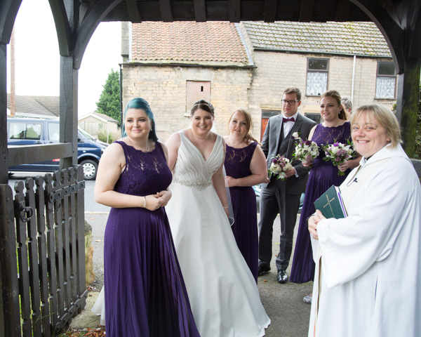 The bride arriving at Bolsover church with her bridal party