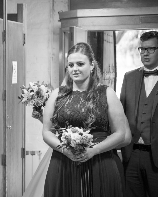 Bridesmaid about to walk down the aisle at Bolsover Church