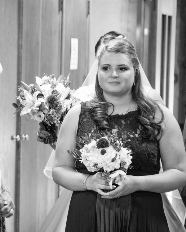 Bridesmaid walking down the aisle at Bolsover parish church
