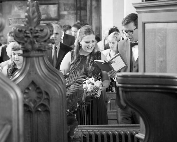 Guests singing during the wedding ceremony at Bolsover parish church