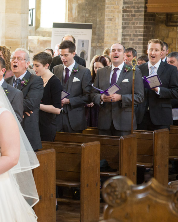 Groomsmen singing hymns during the ceremony at Bolsover parish Church