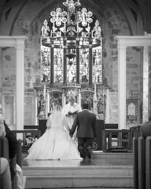 Bride and groom at the front of the church during their wedding ceremony at Felkirk church shafton