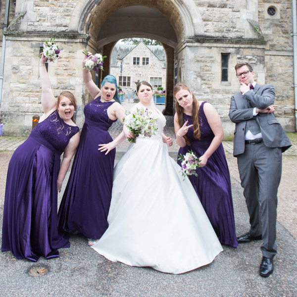 Bridal party posing outside Thoresby courtyard