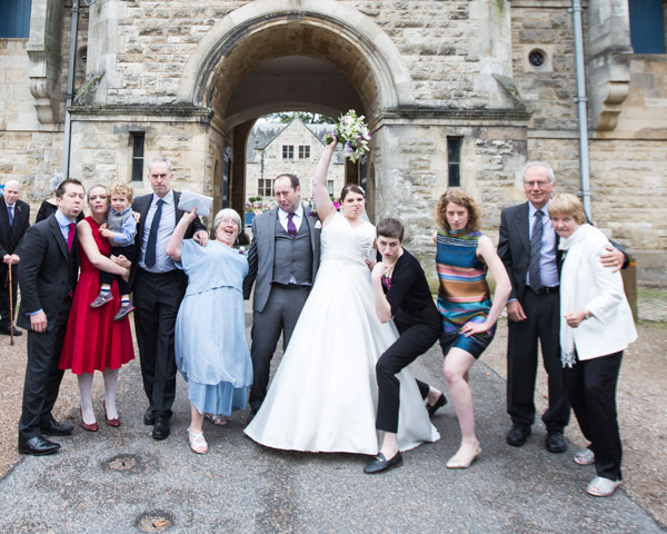 Wedding party pulling silly poses at Thoresby courtyard wedding