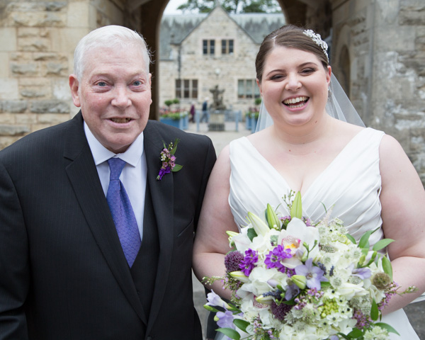 Bride and Grandad posing outside Thoresby Courtyard