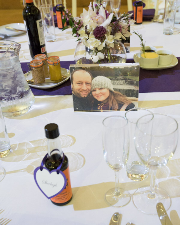 Photographs of the bride and groom as table numbers