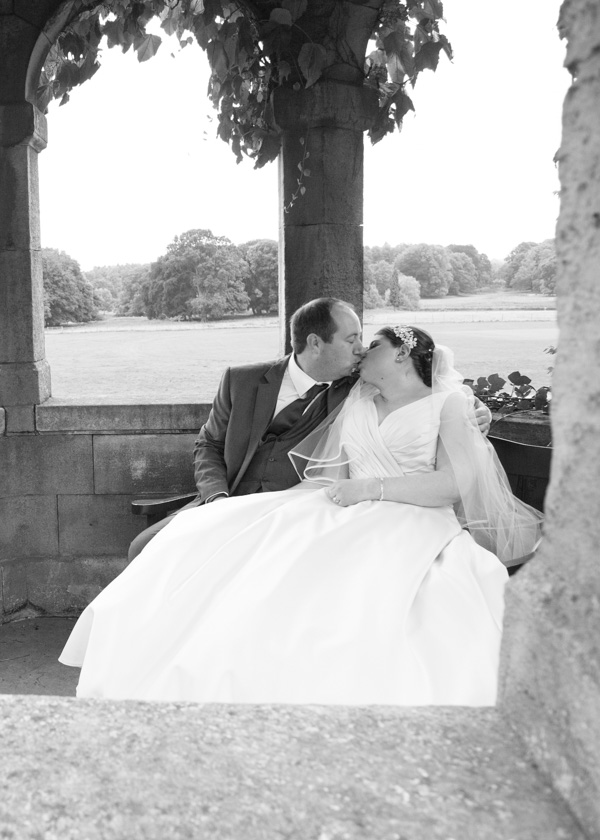 Bride and groom kissing in one of the turrets at THoresby Hall weddings
